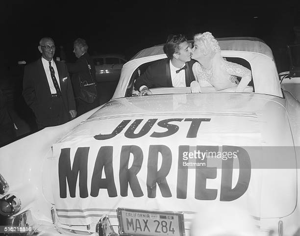 1/15/1958Palos Verdes CA Actress Jayne Mansfield receives a kiss from her bridegroom Mickey Hargitay following their wedding ceremony at the Glass...