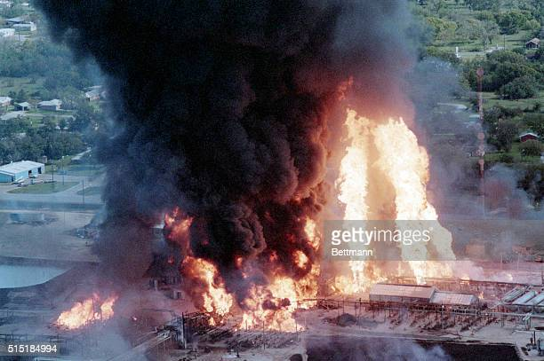 11/5/85Mont Belvieu Texas Towers of flame shoot skyward from a petroleum plant explosion and fire 11/5 Two men were reported missing in the fire at...