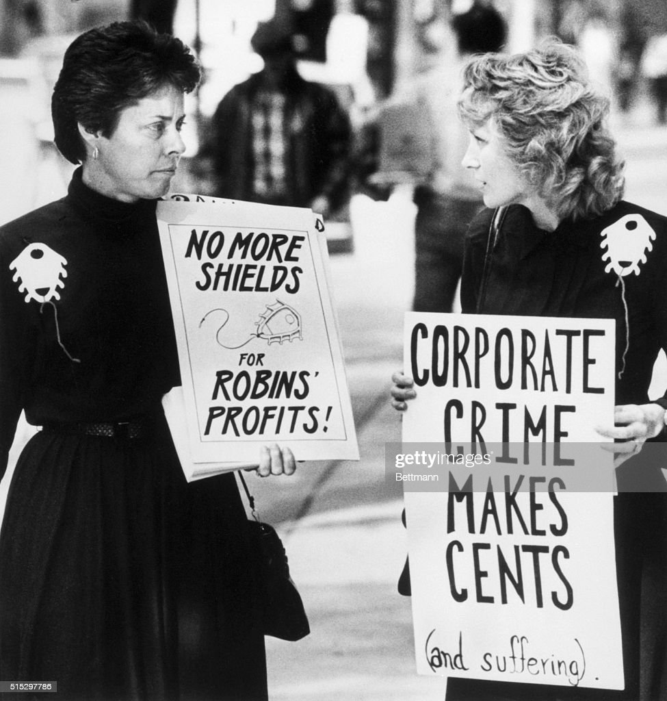 Karen Hicks & Fran Cleary Protest W/Sign : News Photo