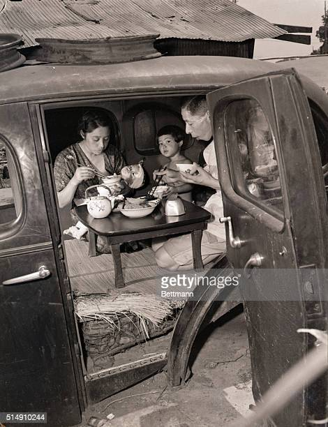 11/6/1947Tokyo JapanThis auto body now serves as a dining room for Shinkichi Shirokane his wife and three children but once it housed the entire...