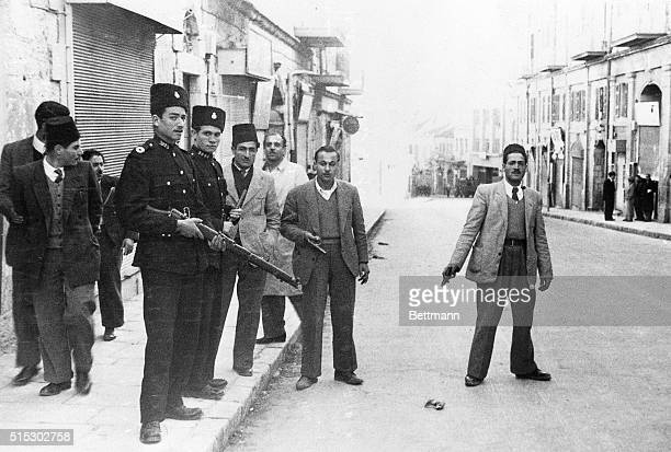 1/16/1948JerusalemIsraelWith pistol in hand Two members of the illegal armed forces contest to be photographed in Jerusalem's main street Two Arab...
