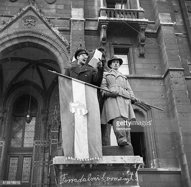 11/6/1956Budapest Hungary Standing by a Hungarian Nationalist flag one of the leaders of the uprising against Soviet domination addresses a crowd...