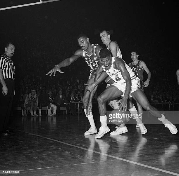 1/16/1962St Louis MO Oscar Robertson Cincinnati does some pretty fancy dribbling trying to get around Wilt Chamberlain Phil 76er during the 3rd...