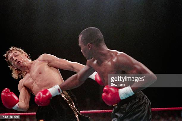 Las Vegas, NV- Sugar Ray Leonard lands a right to the head of Donny Lalonde in their title fight, which Sugar Ray won by TKO in the ninth round.