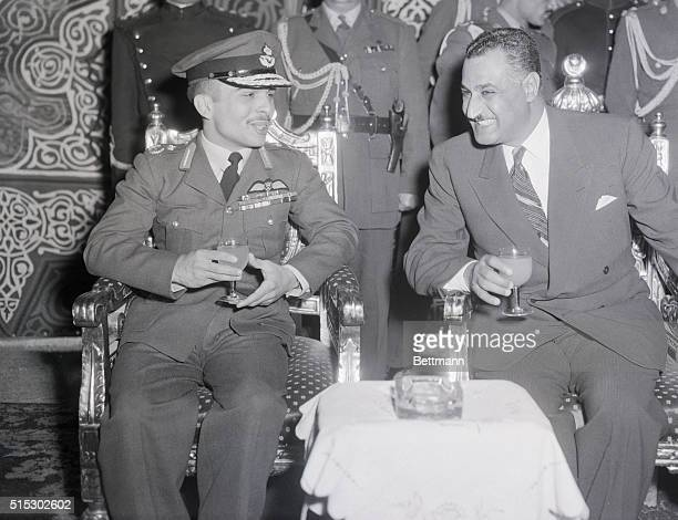 Cairo, Egypt- In a reception tent at Cairo Airport, Jordan's King Hussein and Egyptian President Gamal Abdel Nasser enjoy a drink as they talk...