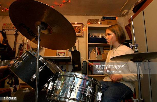 COKelly Harbolt <cq> is a music teacher that teaches young kids to play rock and roll She is a first and second grade teacher at Slavens Elementary...