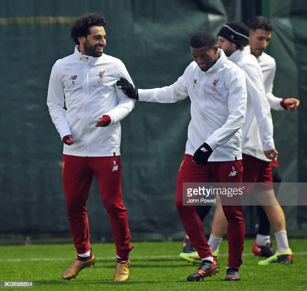 Mohamed Salah with Georginio Wijnaldum of Liverpool during a training session at Melwood Training Ground on January 11 2018 in Liverpool England