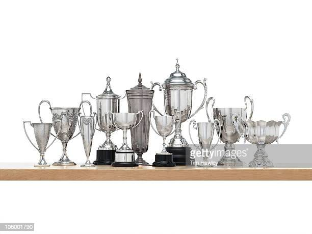 11n Silver trophies on maple shelf