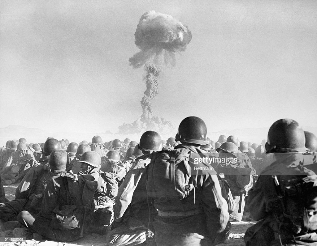 Troops Watching Atomic Bomb Explosion : News Photo