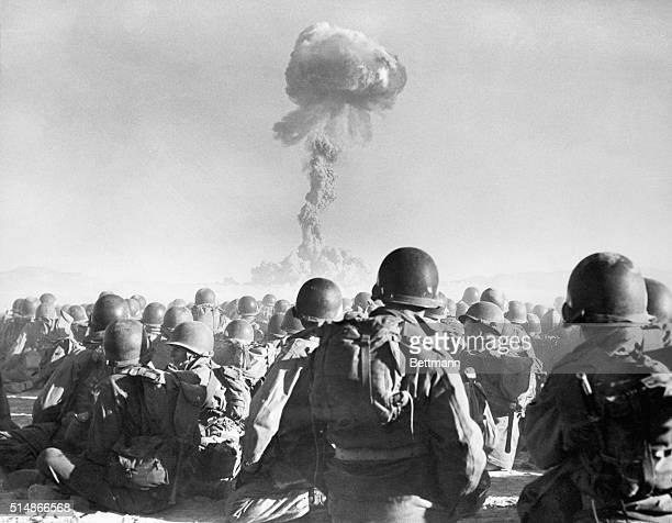 11th Airborne division troops watch an atomic explosion at close range at the AEC's testing grounds in the Las Vegas desert. The troops participate...