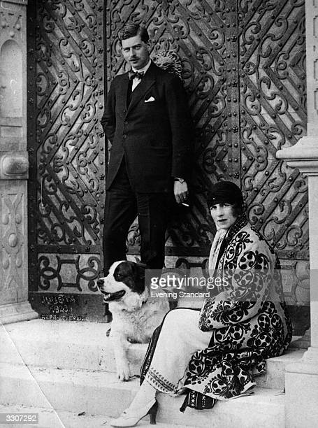 King Carol II of Romania as Crown Prince of Romania with his wife Helen formerly Princess Helen of Greece and their dog at the gate of their country...