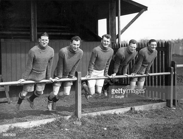 Members of Huddersfield Town football team training at Buxton Derbyshire for their forthcoming FA Cup Final match against Arsenal at Wembley Left to...