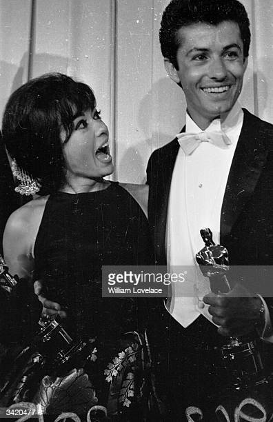 Actress and singer Rita Moreno with American actor George Chakiris at the Oscars award ceremony in Hollywood. Chakiris is holding his Oscar.