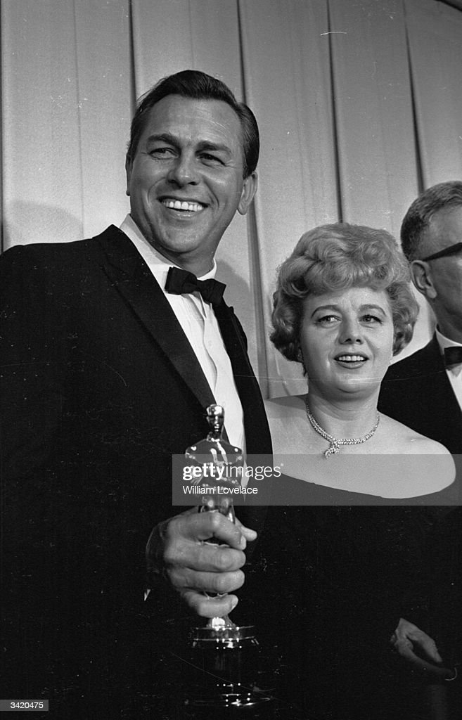American film actress Shelley Winters with actor and singer Howard Keel, holding an Oscar, at the annual film award ceremony in Hollywood.