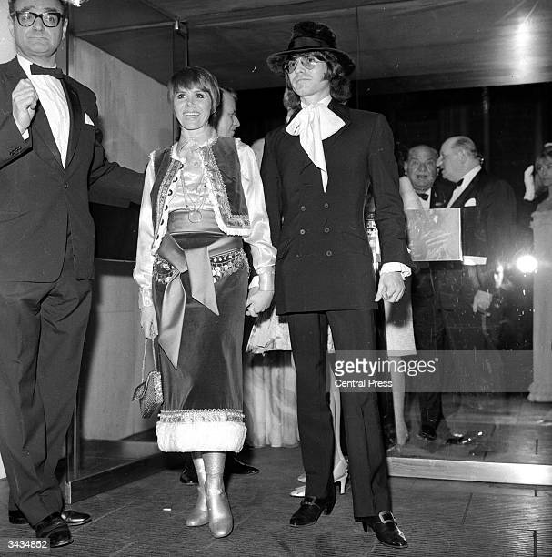 English actress Judy Carne and fiance US photographer Dean Goodhill arriving at the Paramount cinema Piccadilly Circus London for the world premiere...