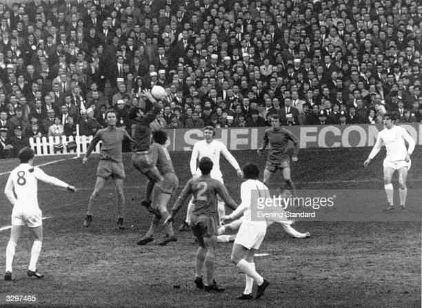 Chelsea goalkeeper Peter Bonetti gathers the ball during the FA Cup Final between Chelsea FC and Leeds United FC at Wembley Other players taking part...
