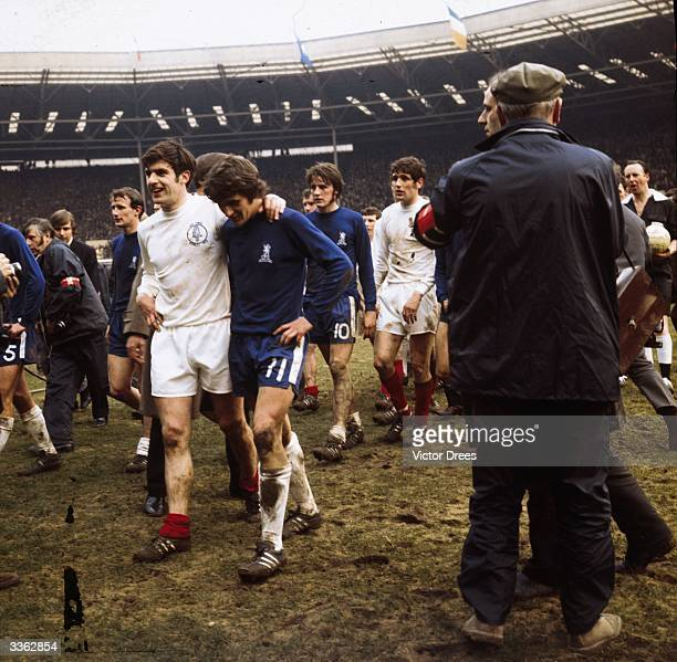 Members of Chelsea and Leeds United walking off the pitch at Wembley Stadium after their 22 draw in the FA Cup final Chelsea won the replay