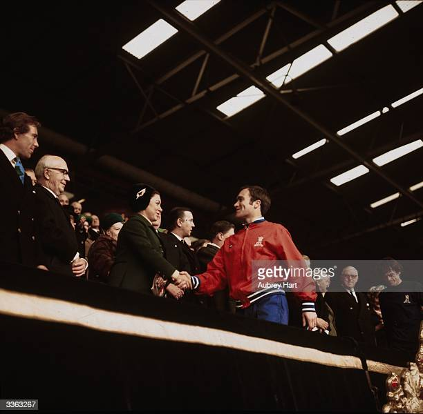 Ron Harris of Chelsea Football Club shakes hands with Princess Margaret after his team's FA Cup Final match against Leeds United ended in a 22 draw...
