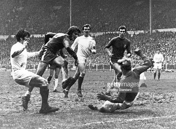 The Leeds United goalkeeper attempts a sliding save from a Chelsea shot in the FA Cup final at Wembley.