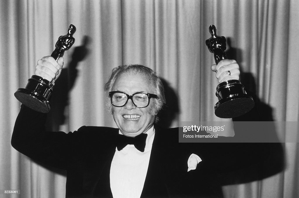 British actor and film director Richard Attenborough smiles and holds up two of his Oscars for Best Director and Best Picture for his film, 'Gandhi,' during the 55th Annual Academy Awards, at the Dorothy Chandler Pavilion, Los Angeles, California.