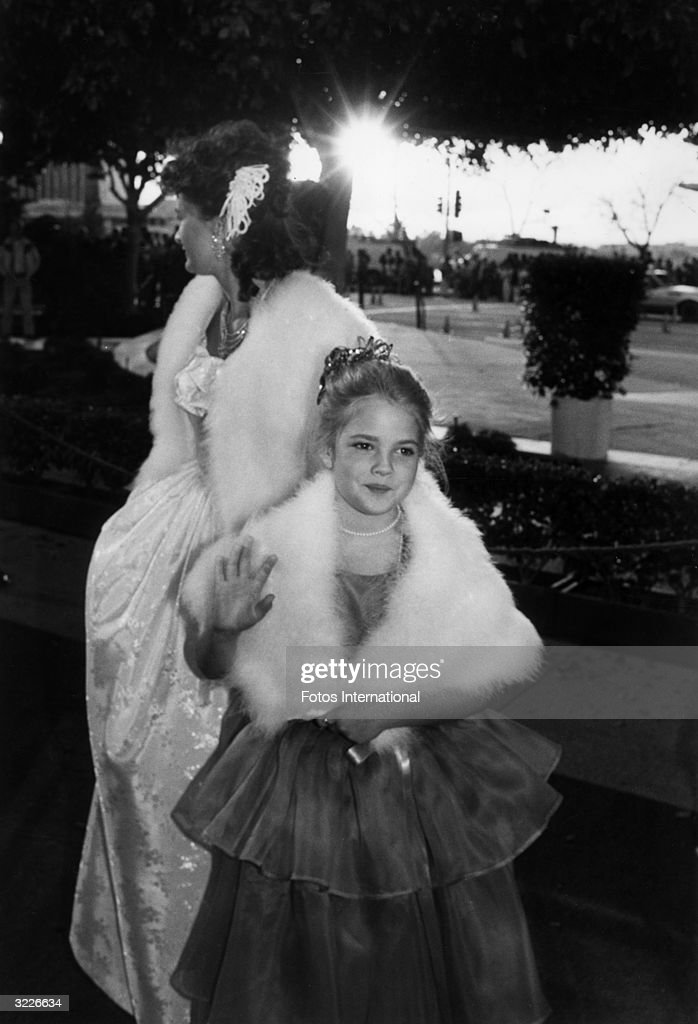 Child actor Drew Barrymore waves as she arrives with her mother, actor Ildiko Jaid, at the 55th annual Academy Awards, Dorothy Chandler Pavilion, Los Angeles Music Center, California. Barrymore had appeared in director Steven Spielberg's Oscar-winning film, 'E.T. The Extra-Terrestrial.'