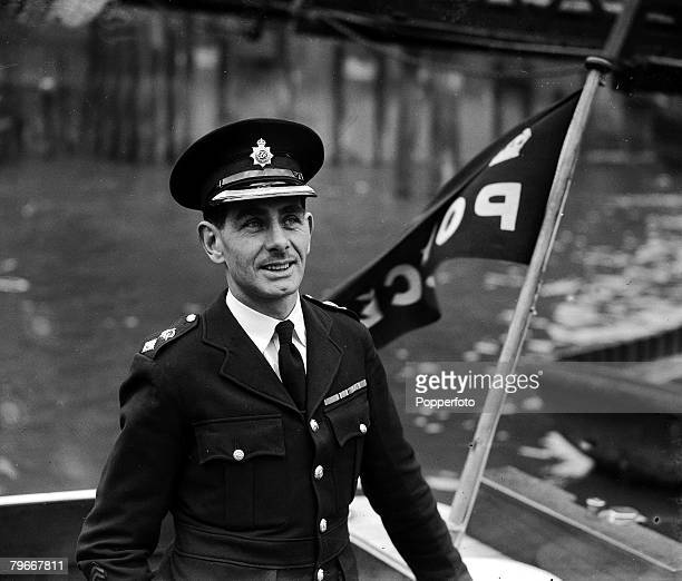 11th April Superintendant T Fallon Chief of the Thames divisional police force from Teddington Lock to Dartford Creek pictured on his launch on the...
