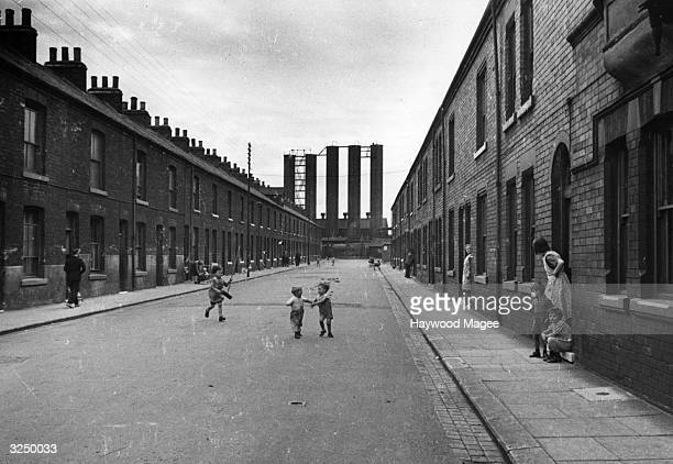 Children playing in a Victorian slum street in Middlesbrough Original Publication Picture Post 2062 Middlesbrough The Plan Matures pub1945