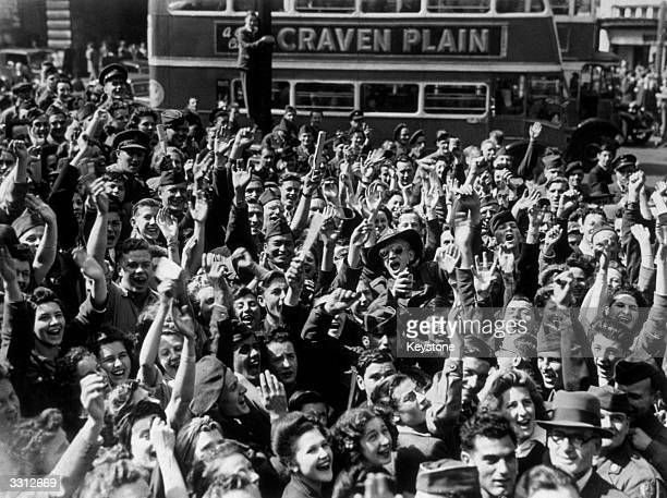 Crowds in London's streets cheering loudly when the news was received of the Japanese surrender