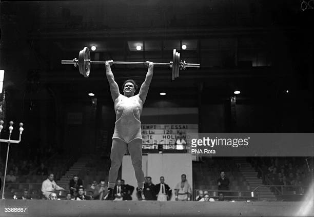 Abraham Charity of Holland takes part in the Super Heavyweight Weightlifting at the 1948 Olympics in London comin g third with a load of 2645 lb
