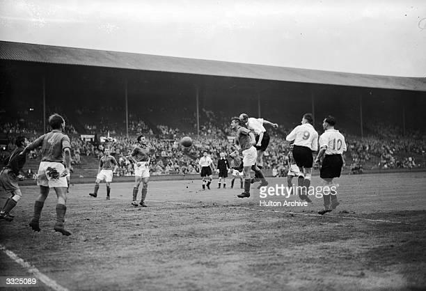 Players vie for the ball during the Great Britain v Yugoslav semifinal football match at Wembley Stadium Olympic Photo Association Photo