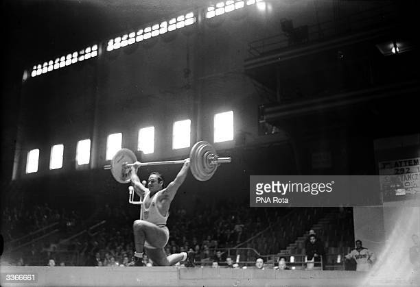 Stanley Stanczyk of USA lifts his way to victory at the 1948 Olympic Light Heavyweight Weightlifting in Earl's Court London with a total load of 9195...