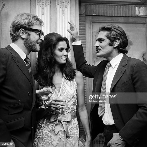 The stars of the film ' A Last Valley' British actor Michael Caine Brazilian actress Florinda Bolkan and Egyptian actor Omar Sharif at a reception at...