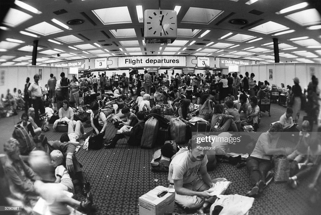 Holiday-makers waiting in the departure lounge at Terminal Three of London's Heathrow airport, during delays caused by industrial action taken by Canadian air traffic controllers.