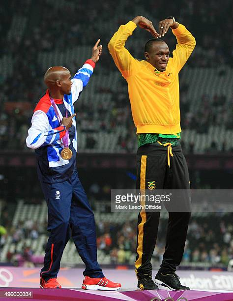 11th August 2012 London 2012 Olympic Games Athletics Men's 5000m champion Mo Farah celebrates with Usain Bolt a member of the 4x100m Relaywinning...