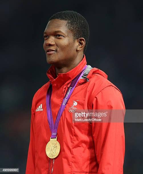 11th August 2012 - London 2012 Olympic Games - Athletics - Men's Javelin Throw Final - Keshorn Walcott stands with his gold medal -