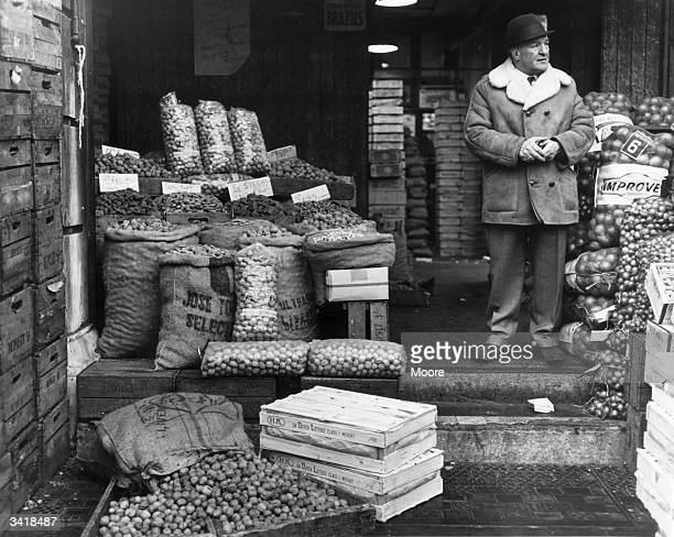 A trader waiting for custom in his nut stall at Covent Garden fruit market London