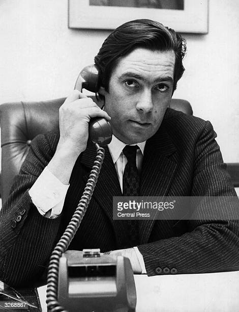 Lord Vestey, joint head of the British Vestey Group shipping company, on the telephone to Buenos Aires, where one of his managing directors, Mr...