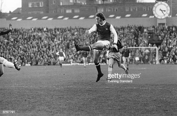 Charlie George of Arsenal shoots during the match at Highbury