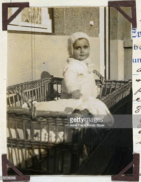 EXCLUSIVE Portrait of Anne Frank's older sister Margot Frank wearing a baby bonnet in her crib Frankfurt am Main GermanyTaken from her photo album