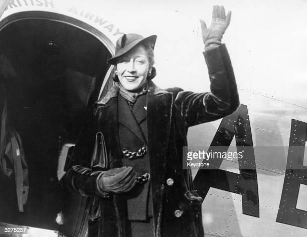 British aviatrix Amy Johnson waving to the crowds at Croydon Airport