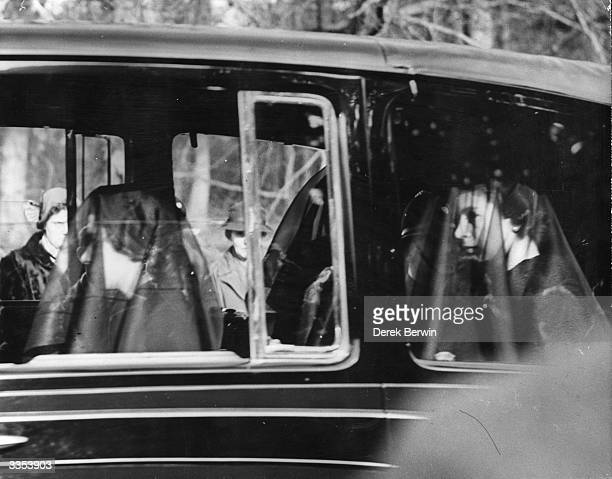 Queen Elizabeth II and Princess Margaret Rose , wearing black veils in the mourning cortege of their late father, King George VI between Sandringham...