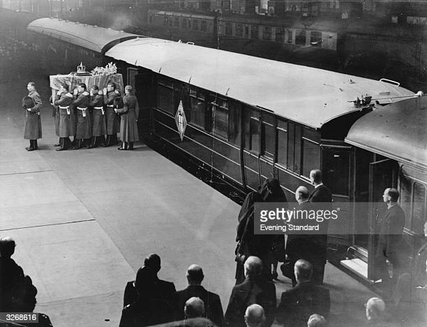The coffin of King George VI disembarking from a train at King's Cross Station in London for the funeral en route for Westminster Hall, where the...
