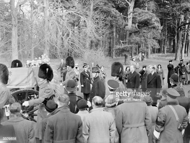 The Dukes of Gloucester and Edinburgh walking behind the funeral cortege on the crowd-lined country road from Sandringham Church to Wolferston...