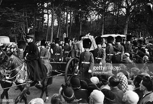 The funeral cortege of King George VI. The gun carriage bears the coffin from Sandringham to Wolferton Station where the body of King George VI is to...