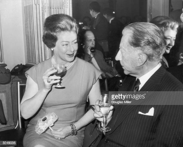 American millionaire J Paul Getty and Mary Teissier attend a party at the Cafe Royal on London's Regent Street to celebrate the cafe's 100th...
