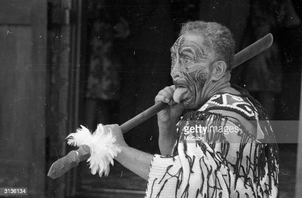 A Maori wields his spear to terrifying effect during the state visit of Queen Elizabeth II and Prince Philip to New Zealand