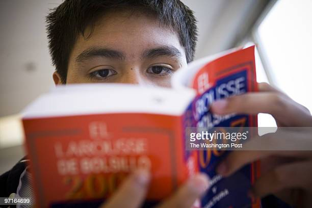 II 11th grader Andres Avendano looks through a dictionary in an International Baccalaureate or IB Spanish program at Annandale High School on Oct 9...