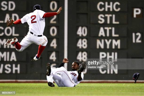 11th Jackie Bradley Jr #19 of the Boston Red Sox slides beneath Xander Bogaerts to catch a fly ball hit by Gregory Polanco of the Pittsburgh Pirates...
