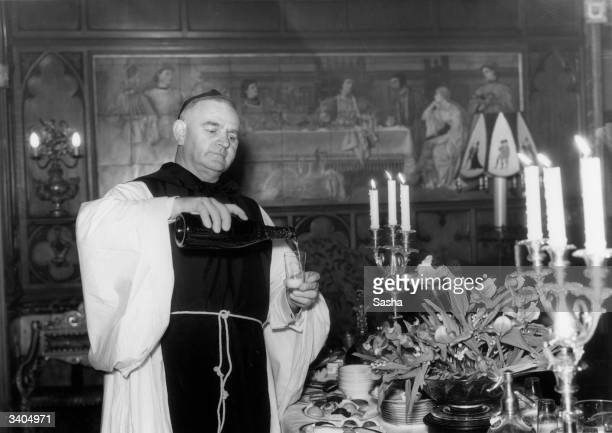 Domestic dressed as a monk pouring drinks at Sir Edward Mountain's party thrown at his medieval house 'The Abbey', Campden Hill, London.