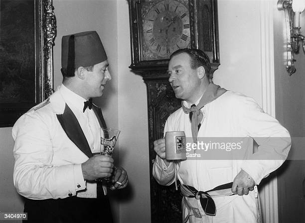 Mr Brian Mountain and Mr R Rickett at Sir Edward Mountain's party thrown at his medieval house 'The Abbey', Campden Hill, London.